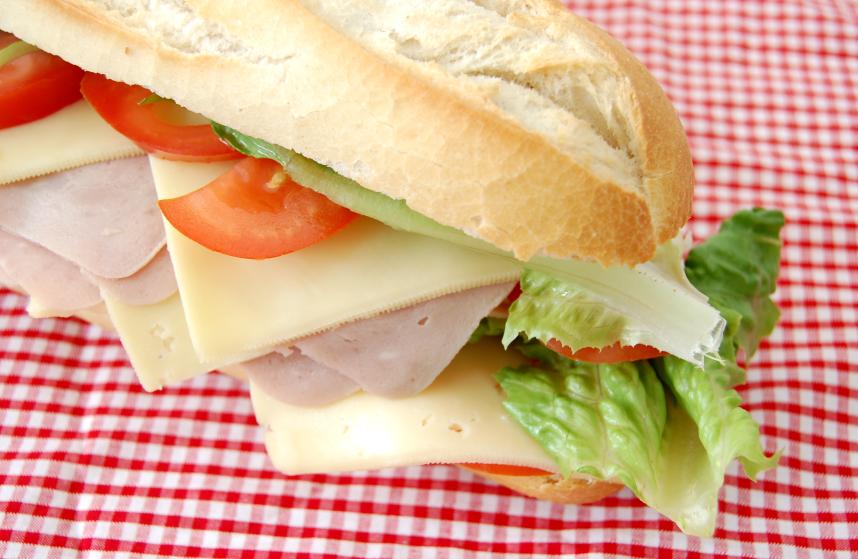 deli sandwich on tablecloth