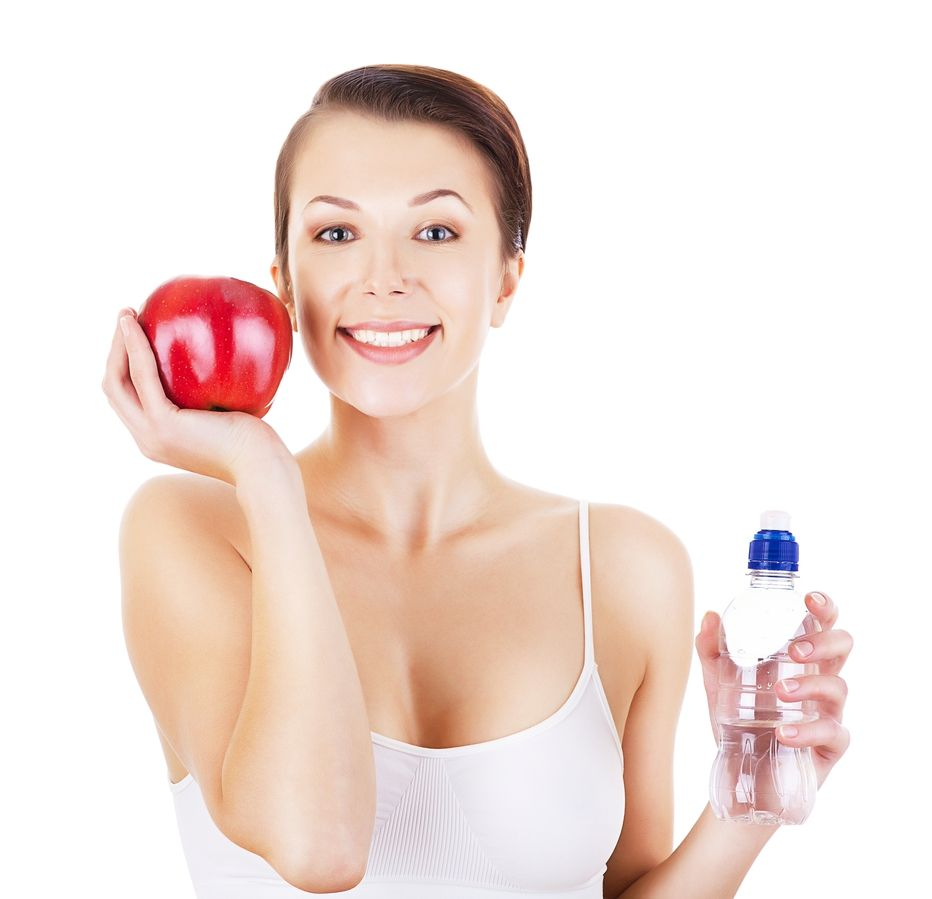girl holding apple and water bottle